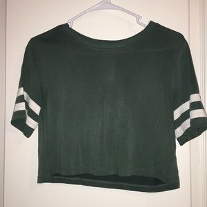 Green crop top tee with white stripes on shoulder